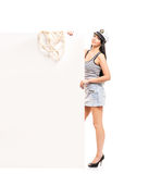 Happy sailor woman posing with a white banner Stock Image