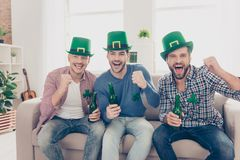 Happy Saint Patrick`s day! Attractive, handsome guys. Happy Saint Patrick`s day! Attractive, handsome joyful guys with bristle shouting screaming with open mouth Royalty Free Stock Image