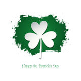 Happy Saint Patrick`s Day celebration card with lucky clover on green brush stroke background. Stock Photos