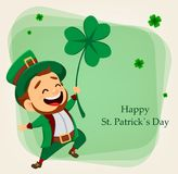 Cartoon funny leprechaun holding clover Stock Photo