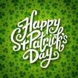 Happy Saint Patrick's day handwritten message, brush pen lettering on green shamrock background postcard, vector Stock Photos