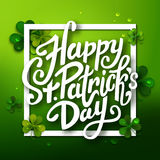 Happy Saint Patrick's day handwritten message, brush pen lettering on green shamrock background in square frame Royalty Free Stock Photography
