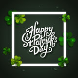 Happy Saint Patrick's day handwritten message, brush pen lettering on green shamrock background in square frame Royalty Free Stock Image