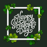 Happy Saint Patrick's day handwritten message, brush pen lettering on green shamrock background in square frame Royalty Free Stock Photo