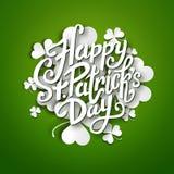 Happy Saint Patrick's Day vector illustration, handwritten brush pen lettering on paper shamrock leaves Stock Photos