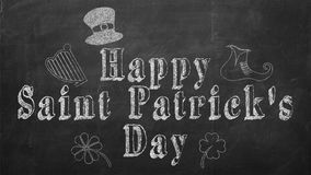 Happy Saint Patrick text decorated with holiday elemtns on blackboard.  Royalty Free Stock Photography