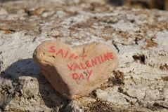 Happy saint valentine's day on a stone heart Royalty Free Stock Images