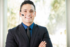 Happy sales rep with headset Stock Photo