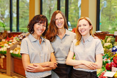 Happy sales team in supermarket Stock Photos