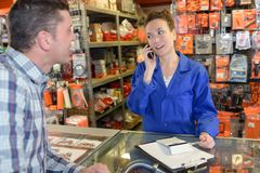Happy salesman assisting customer. Warehouse royalty free stock photo
