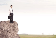 Happy salesman on cliff in the country Stock Photo