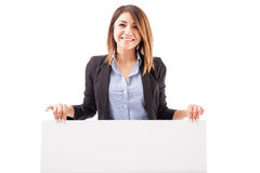 Happy salesperson holding a sign Royalty Free Stock Photo