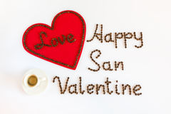 Happy San Valentine with love and a cup of coffee. Happy San Valentine and Love written with coffee beans and a cup of coffee Stock Photography