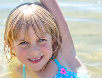 Happy, Sandy Little Girl in the Lake stock photos