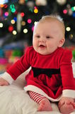 Happy Santa Baby. Happy Baby Girl in santa outfit for christmas Stock Images