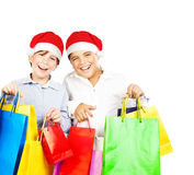 Happy Santa boys with gifts Royalty Free Stock Photography