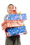 Happy Santa Claus boy with gift boxes Stock Photography