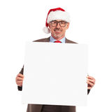 Happy santa claus businessman holding a blank board Royalty Free Stock Image