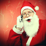 Happy Santa Claus with Cellphone Royalty Free Stock Photography