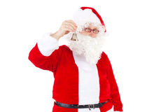 Happy Santa Claus chiming bell. Happy Santa Claus chiming the bell Stock Photo