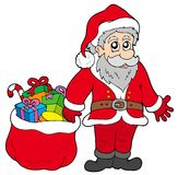 Happy Santa Claus with gifts Stock Image