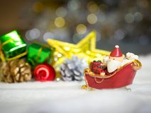 Happy Santa Claus with gifts box on the snow sled the background is Christmas decor.Santa Claus and Christmas decor on the snow. Merry Christmas and happy new Stock Photo
