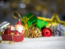 Happy Santa Claus with gifts box on the snow sled going to house. near house have Snowman and Christmas Tree. Santa Claus. Happy Santa Claus with gifts box on Stock Photography