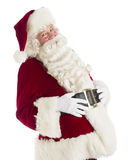 Happy Santa Claus With Hands On Stomach. Portrait of happy Santa Claus with hands on stomach standing against white background Royalty Free Stock Images