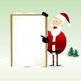 Happy Santa Claus Holding a Blank Sign Royalty Free Stock Photo