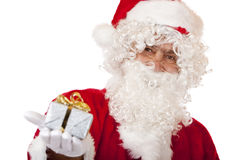 Happy Santa Claus holding Christmas gift Stock Photography
