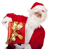 Happy Santa Claus holding Christmas gift Royalty Free Stock Photography