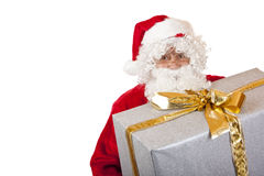 Happy Santa Claus holding Christmas gift box Royalty Free Stock Images