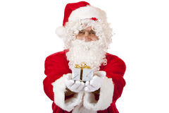 Happy Santa Claus holding Christmas gift in hands Royalty Free Stock Photography