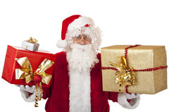 Happy Santa Claus holding Christmas gifts in hands Royalty Free Stock Images