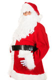 Happy Santa Claus holding his fat belly Royalty Free Stock Photos