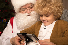 Happy Santa Claus with kid Stock Photo