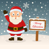 Happy Santa Claus & Merry Christmas Sign Royalty Free Stock Image