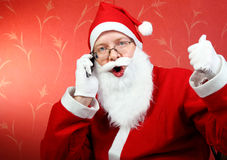 Happy santa claus with phone Stock Photo