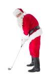 Happy santa claus playing golf royalty free stock photos