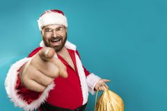 Bad Santa Clous Man. Happy Santa Claus pointing on you, concept christmas Stock Image