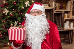 Happy Santa Claus prepared gift for you Stock Image