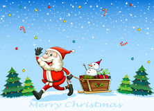 A happy Santa Claus pulling the sleigh with a snowman Stock Images