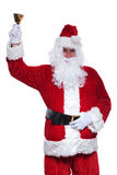 Happy santa claus is ringing his little bell Stock Images
