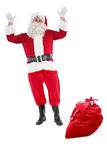 Happy santa claus with sack full of gifts Stock Photography
