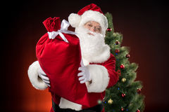 Happy Santa Claus showing big sack Royalty Free Stock Photo