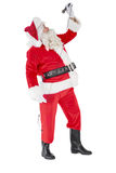 Happy santa claus singing with microphone Royalty Free Stock Images