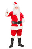 Happy Santa claus standing and giving a thumb up. Full length portrait of a happy Santa claus standing and giving a thumb up on white background Royalty Free Stock Images