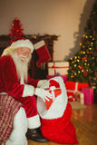 Happy santa claus stocking gifts Stock Photos