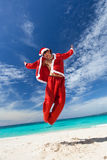 Happy Santa Claus on tropical beach Stock Images