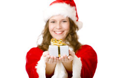 Happy  Santa Claus woman giving Christmas gift Stock Photography